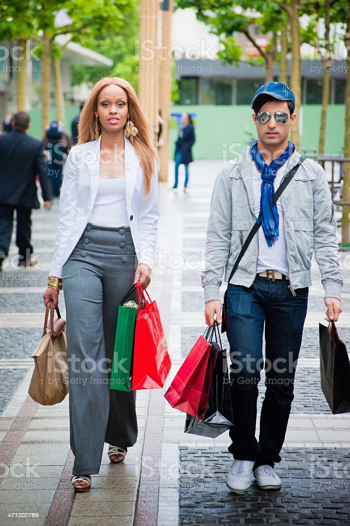Shopping couple walking in the City Streets royalty-free stock photo