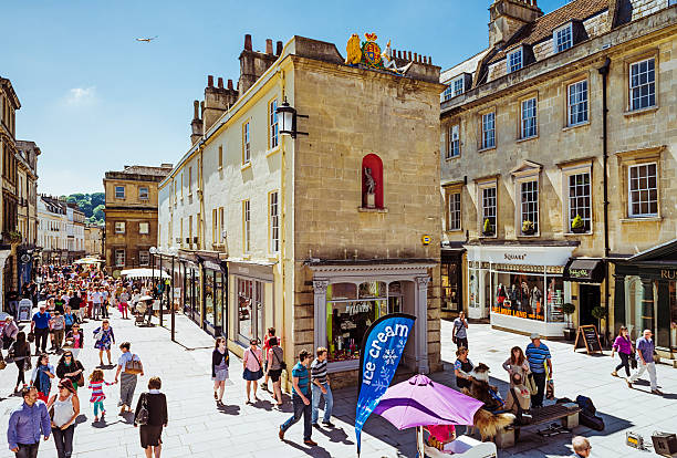 Shopping Day in Bath Bath, England, UK - June 8, 2013: People shopping in the city centre of Bath, Somerset. bath england stock pictures, royalty-free photos & images