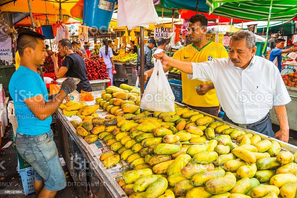 Shopping for fresh fruit in outdoor market Kuala Lumpur Malaysia stock photo