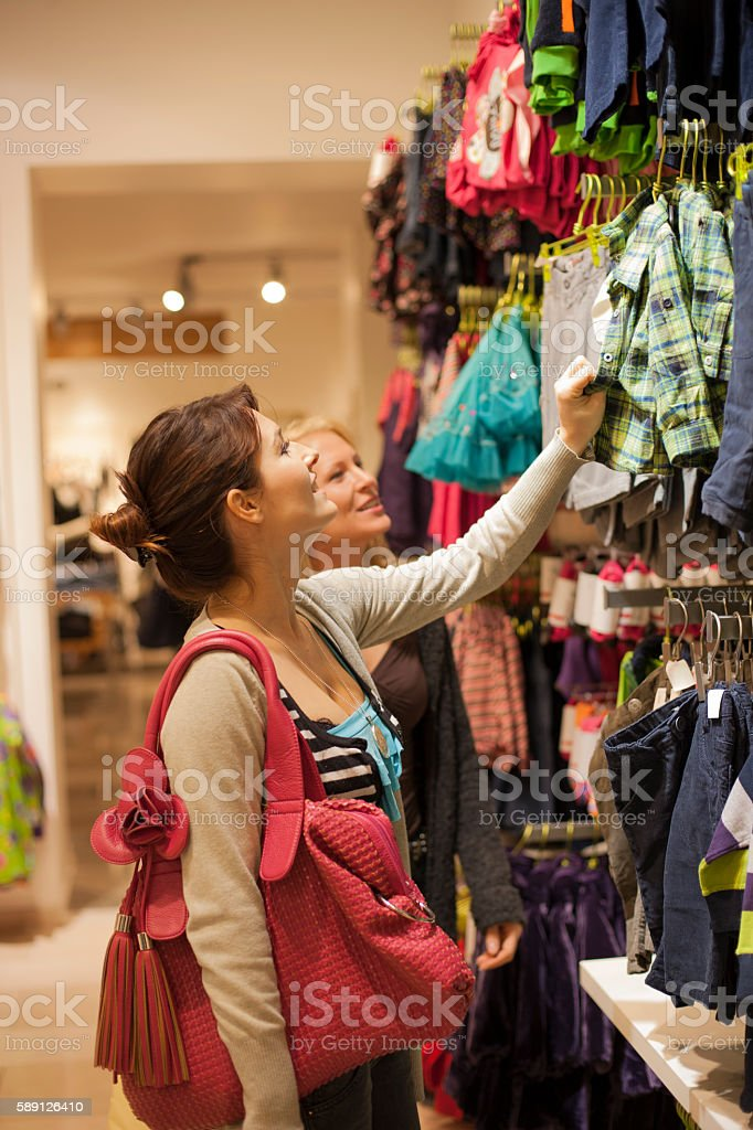 shopping for kids clothing stock photo