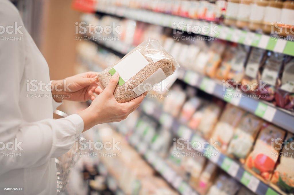 Shopping for organic rice stock photo