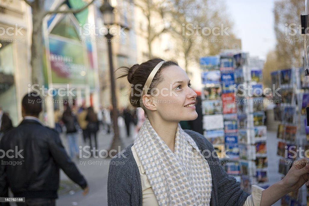 Shopping for postcards royalty-free stock photo