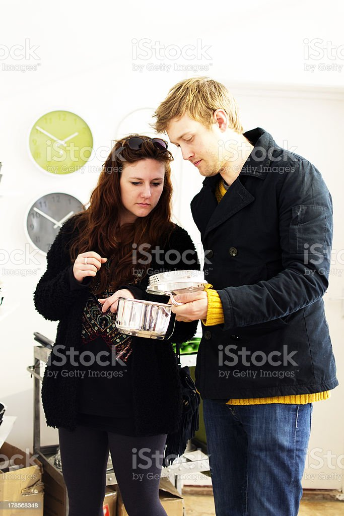 Shopping for pots and pans royalty-free stock photo