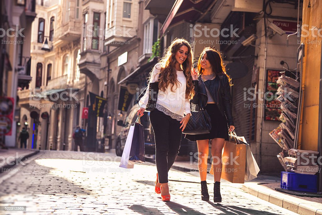 Shopping friends in the streets stock photo