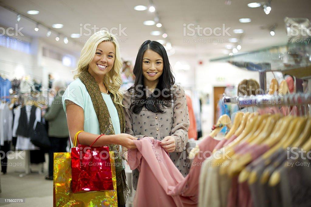 Shopping friends looking at camera royalty-free stock photo