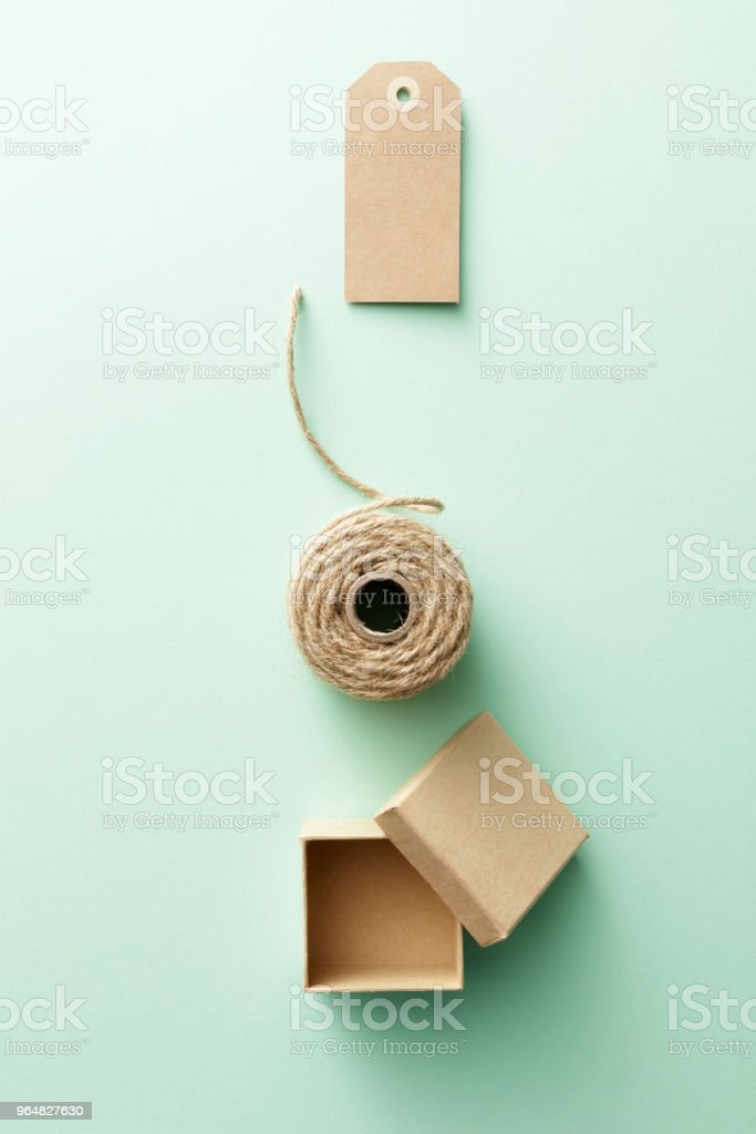 Shopping: Gift Box, Rope and Label Still Life royalty-free stock photo