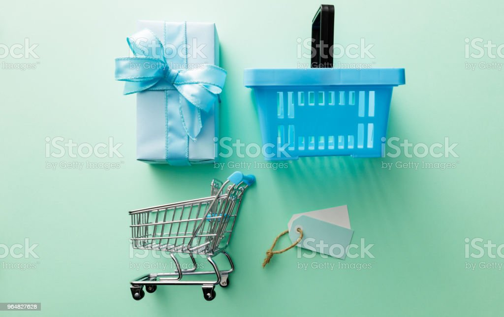 Shopping: Gift, Shopping Cart, Shopping Basket and Labels Still Life royalty-free stock photo