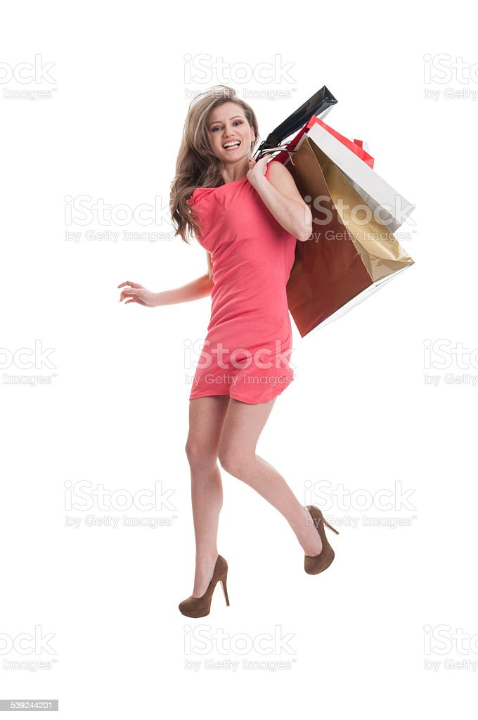 Shopping girl jumping for joy royalty-free stock photo