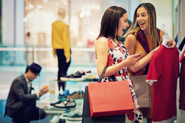 11 Beautiful Girl At Clothes Shop Looking For A Dress Stock Photos,  Pictures & Royalty-Free Images - iStock