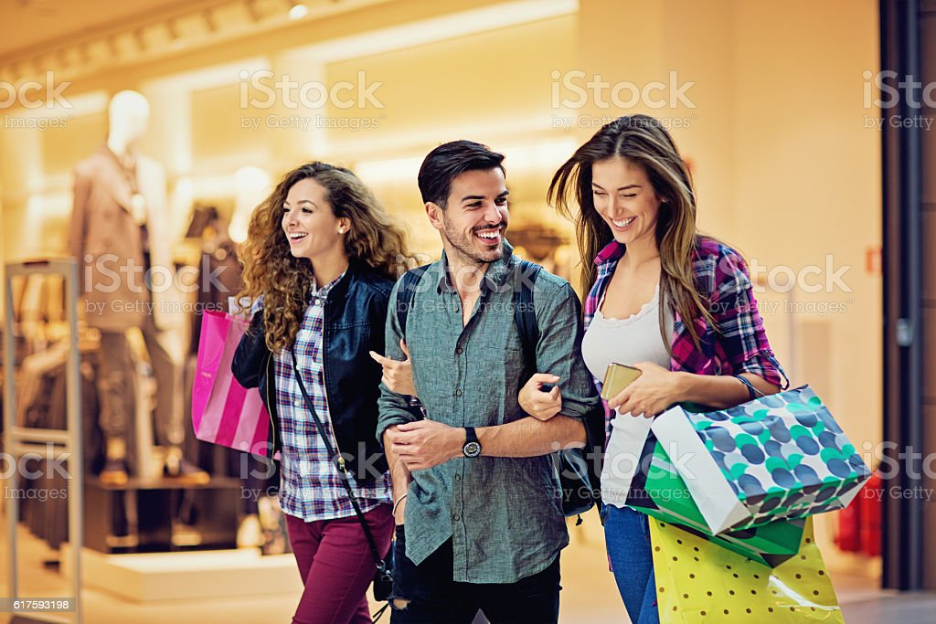 Shopping girls and man are walking in the Mall - foto de acervo