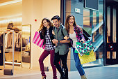 istock Shopping girls and man are walking in the Mall 623107418