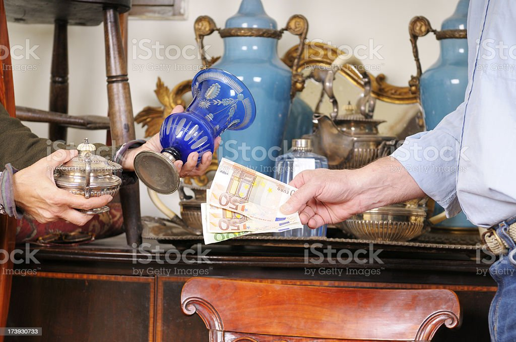 Shopping in an Antique Shop royalty-free stock photo