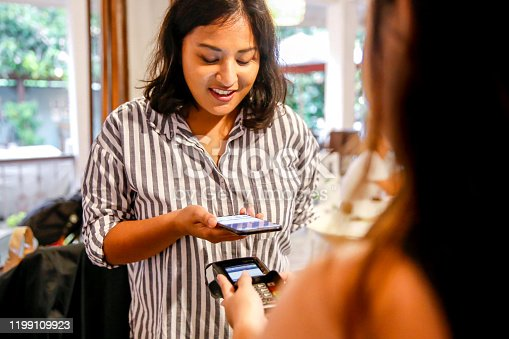 Close up Asian customer paying food and drinks with smart phone app