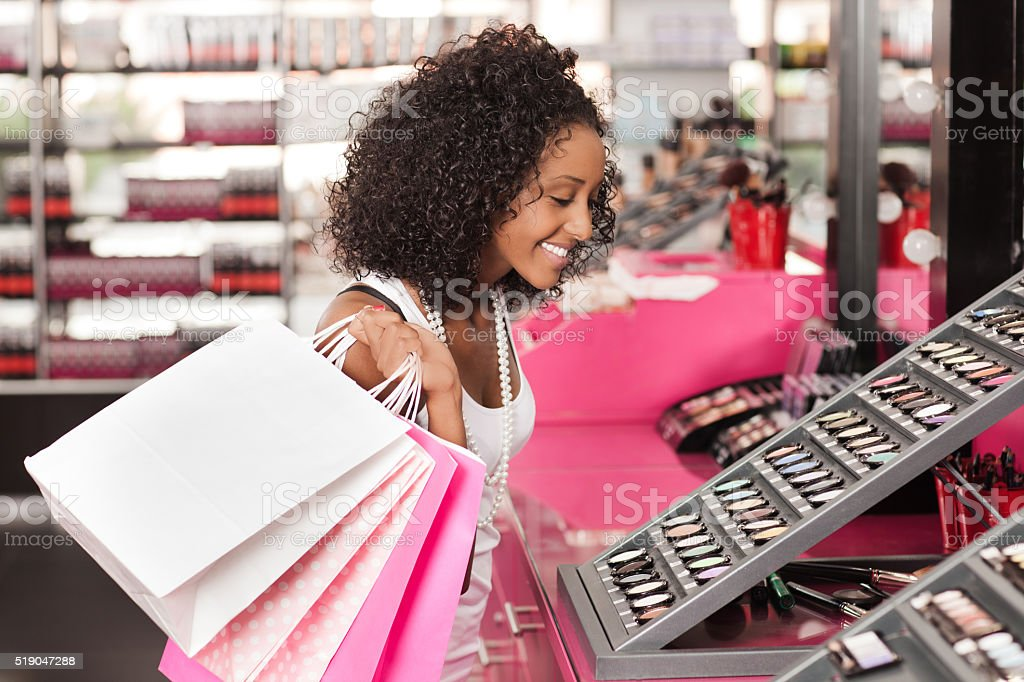 Shopping in cosmetics store. stock photo