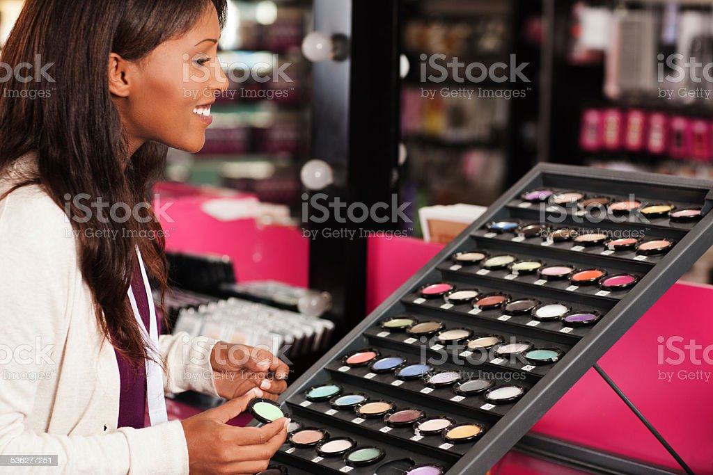 Shopping in cosmetics store stock photo
