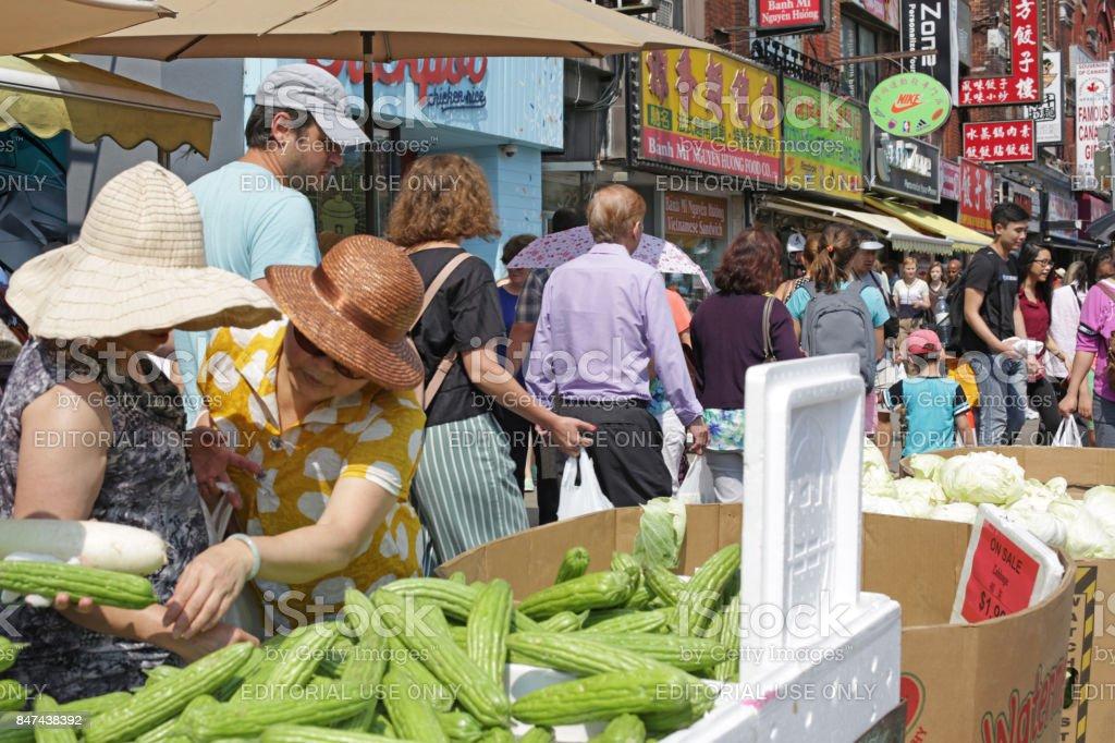 Shopping in Toronto's Chinatown on Spadina Avenue stock photo