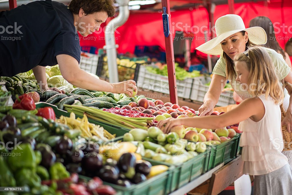Shopping in vegetable market - Royalty-free 2015 Stock Photo