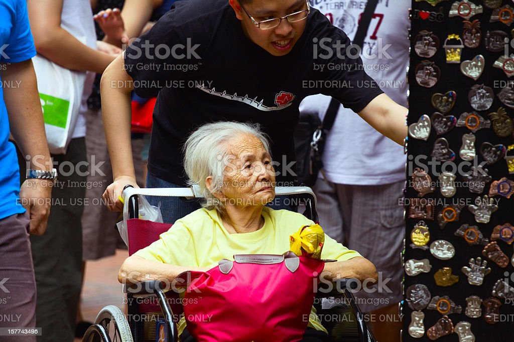 Shopping in wheelchair at high age royalty-free stock photo