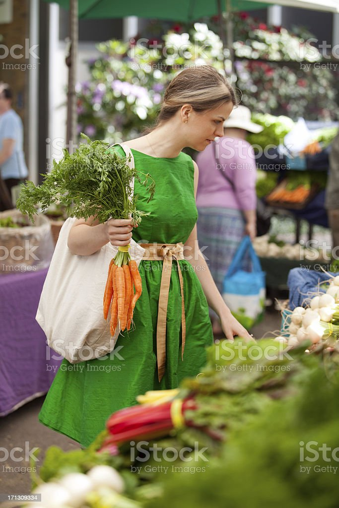 Shopping inside a farmers market royalty-free stock photo