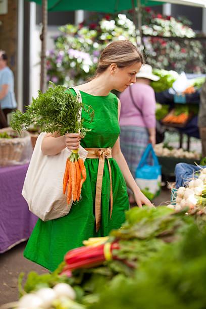 Shopping inside a farmers market stock photo