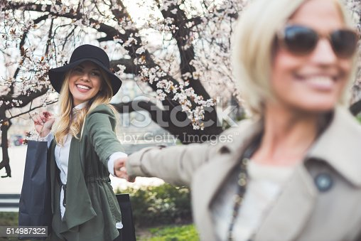 Shot of two young female friends out for a day shopping.