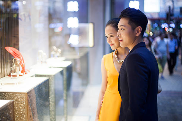 Shopping jewelry Young couple looking at jewelry in Hong-Kong shopping couple asian stock pictures, royalty-free photos & images