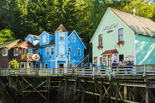 Shopping Ketchikan Ketchikan, Alaska, USA - August 15, 2007: Tourists visit the many shops on Creek Street in  Ketchikan, Alaska.  This narrow street up on pilings was once the Red Light district of town