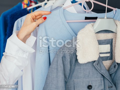 672064598istockphoto shopping leisure female lifestyle woman hand rack 1141329977