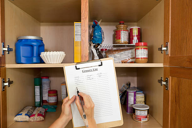 shopping list and food pantry - inside pantry grocery cupboard bildbanksfoton och bilder