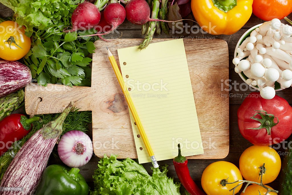 Shopping list and vegetables stock photo