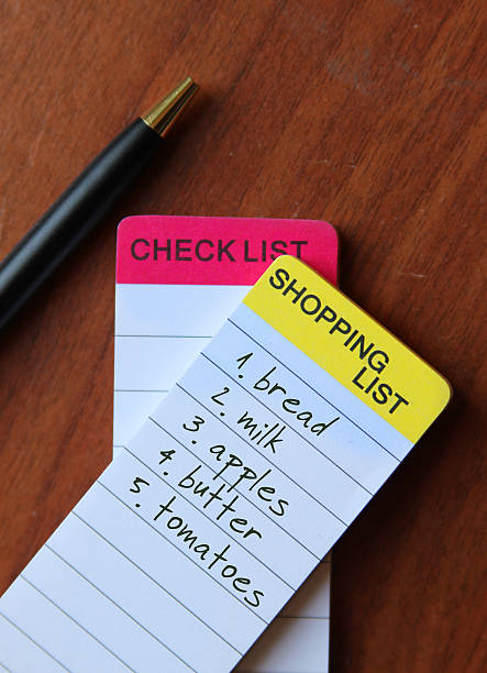 shopping list in wodden table stock photo