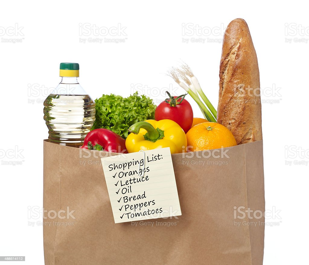 Shopping list on a bag of groceries stock photo