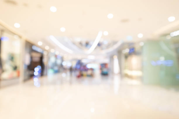 shopping mall abstract defocused blurred background stock photo