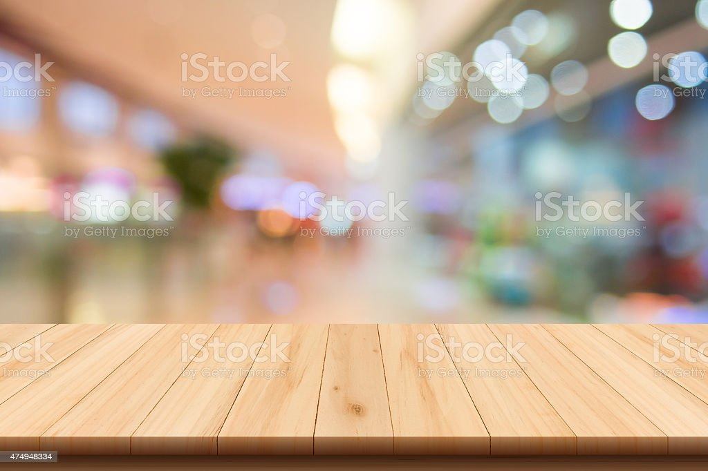 Shopping mall blur background and wooden floor stock photo
