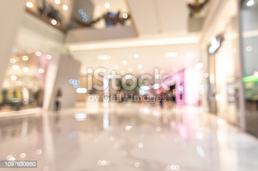 istock Shopping mall blur background with blurry interior view retail shop fashion window display store front and counter selling luxury merchandise products inside lobby hallway 1097630950