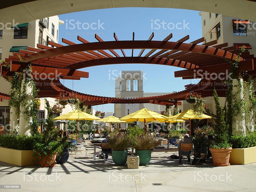 Shopping mall dining area on a sunny day stock photo