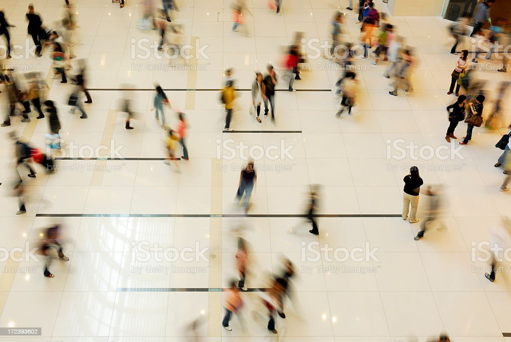 A shopping mall filled with people royalty-free stock photo