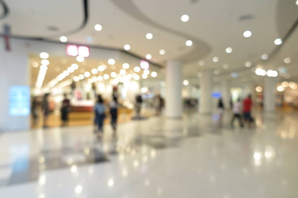Shopping mall interior with people in blur background stock photo
