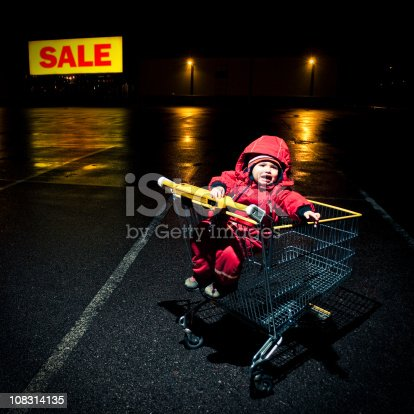 Little girl forgotten at the parking lot of a Shopping mall.http://www.phototrolley.com/downloads/BannersIstock/BannerBizarre.jpg