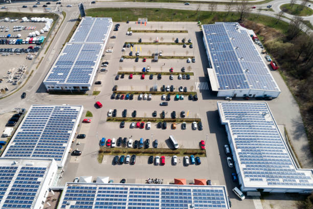 Shopping mall with solar panels and parking lot from above stock photo