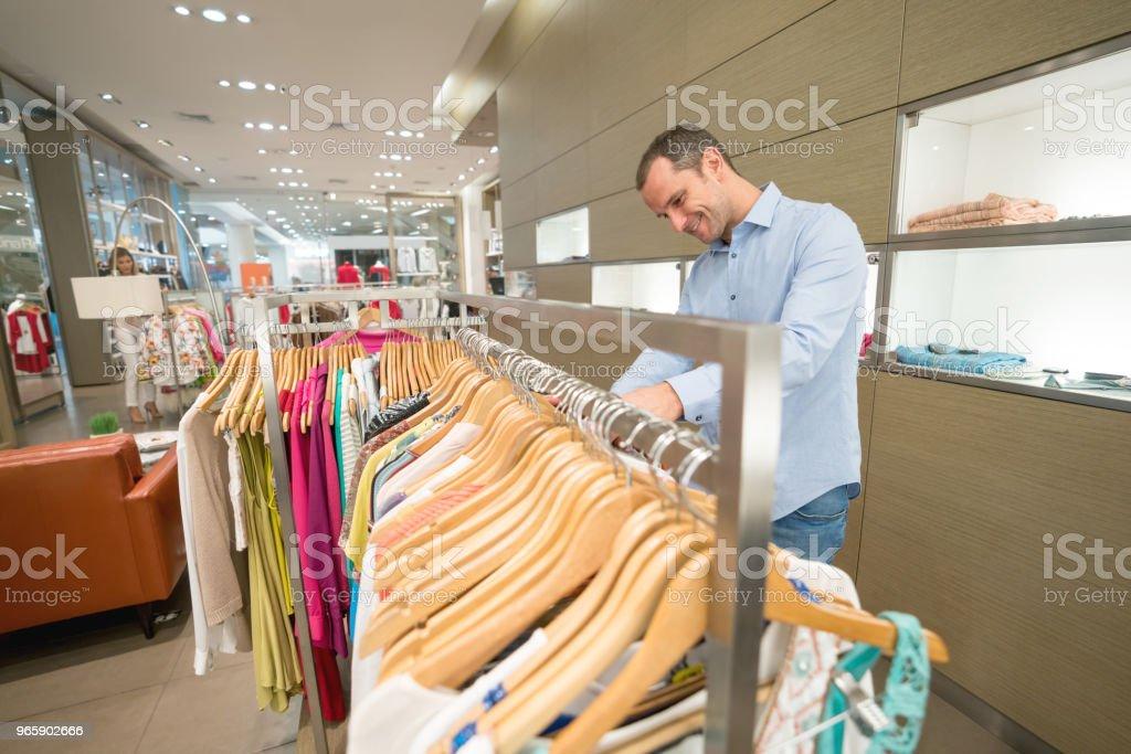 Shopping man looking at clothes at a store - Royalty-free 40-49 Years Stock Photo