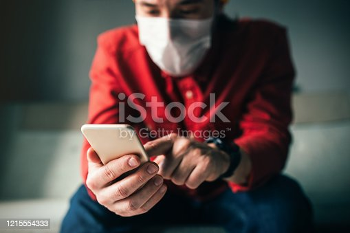 istock Shopping on Virus Times at Home, Man wearing a mask 1215554333