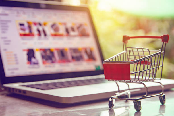Shopping online concept - shopping cart or trolley on a laptop keyboard. Shopping service on The online web. Shopping online concept - shopping cart or trolley on a laptop keyboard. Shopping service on The online web. catalog stock pictures, royalty-free photos & images