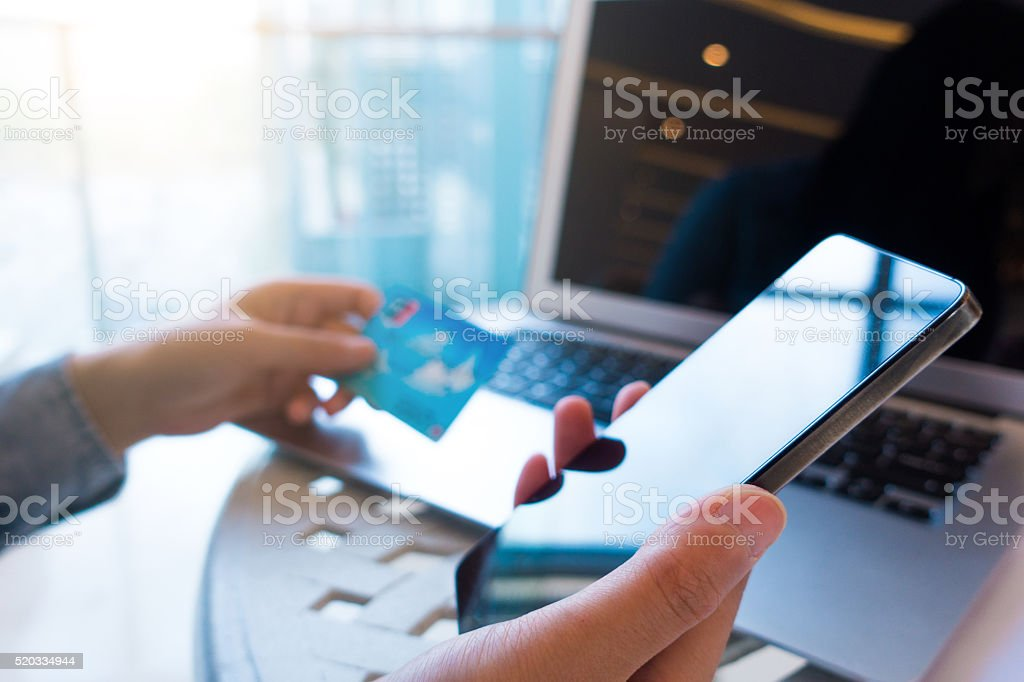 shopping online using mobile phone stock photo