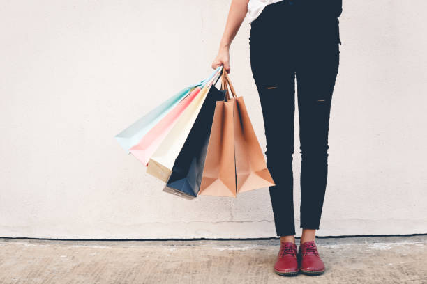 shopping woman wear black jeans holding shopping bag on the ground thailand mall stock pictures, royalty-free photos & images