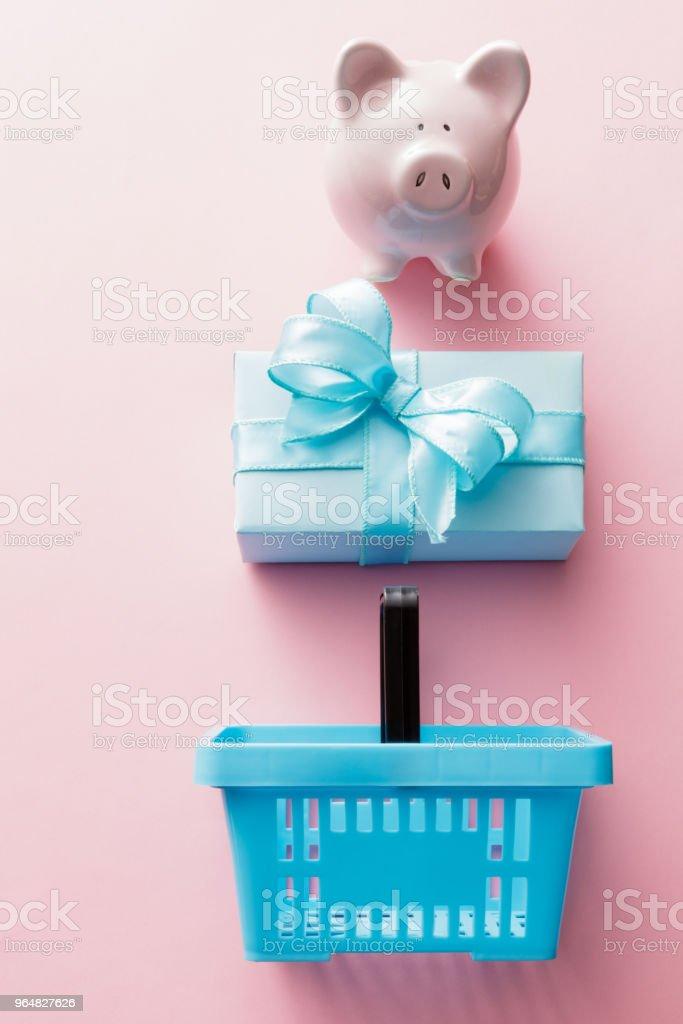 Shopping: Piggy Bank, Gift and Shopping Basket Still Life royalty-free stock photo