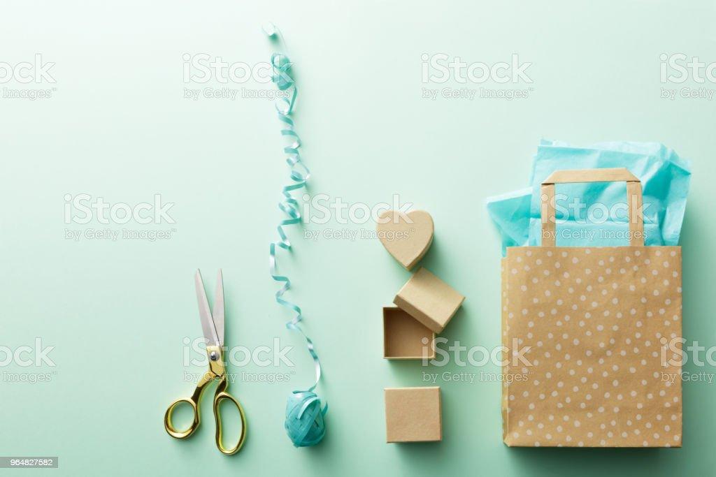 Shopping: Shopping Bag, Gifts, Ribbon and Scissors Still Life royalty-free stock photo