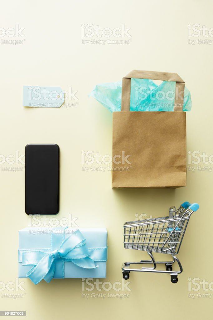 Shopping: Shopping Cart, Gift and Smartphone Still Life royalty-free stock photo