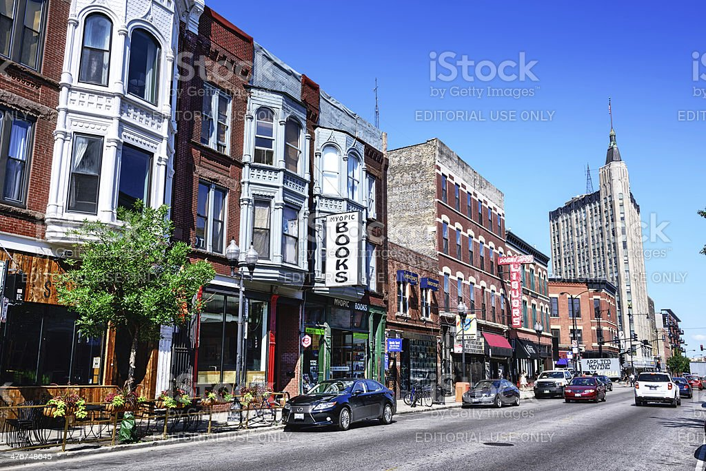 Shopping street in Wicker Park, Chicago Chicago, USA - July 20, 2013: Shops on Milwaukee Avenue in Wicker Park, a neighborhood in the Chicago community of West Town. City street with  background people. Northwest Tower on right. 19th Century Style Stock Photo