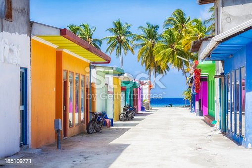Shopping street with typically colorful house facades in Maafushi a local island in the Maldives.